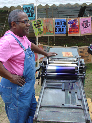 Amos Kennedy talking about printing presses.