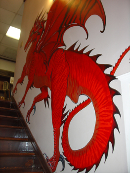 There is a big red dragon painted on the wall, on your way upstairs.